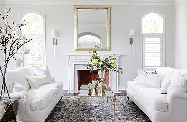 Almost white gray walls in a traditional living room. Benjamin Moore Paper White