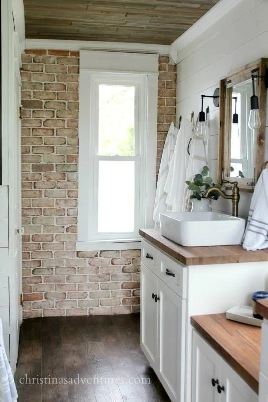 One of the many ways to make a new home feel old is to add brick veneer to a wall
