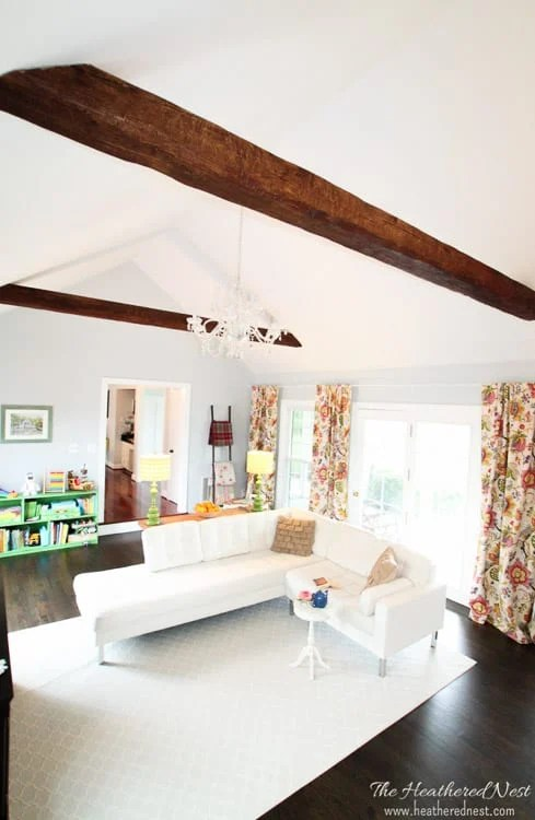 Faux wood beams are one of the many ways to add character to a living room