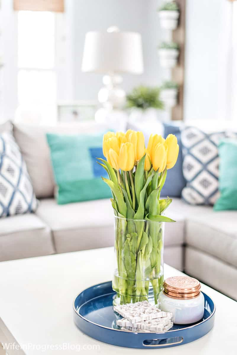 Yellow contrasts beautifully in a blue and green living room decor
