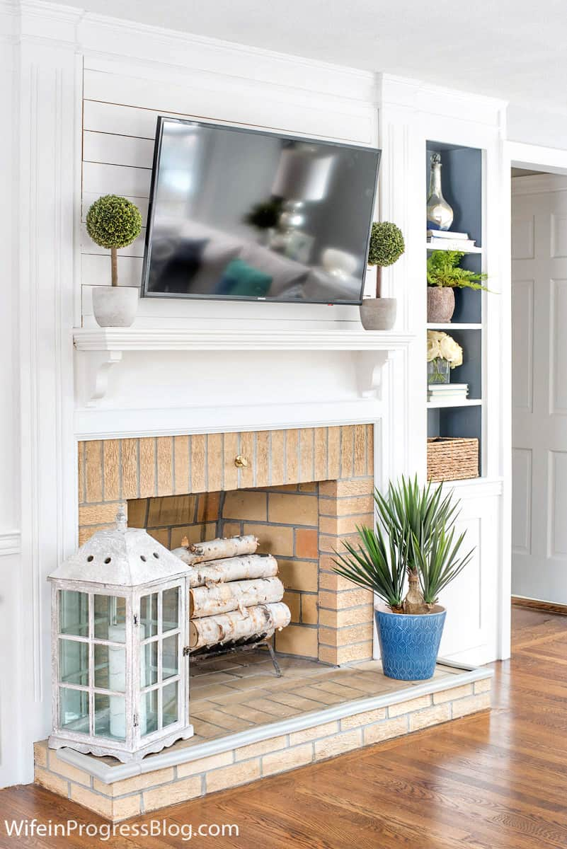 Fireplace with backs of built-ins painted Sherwin Williams Serious Gray