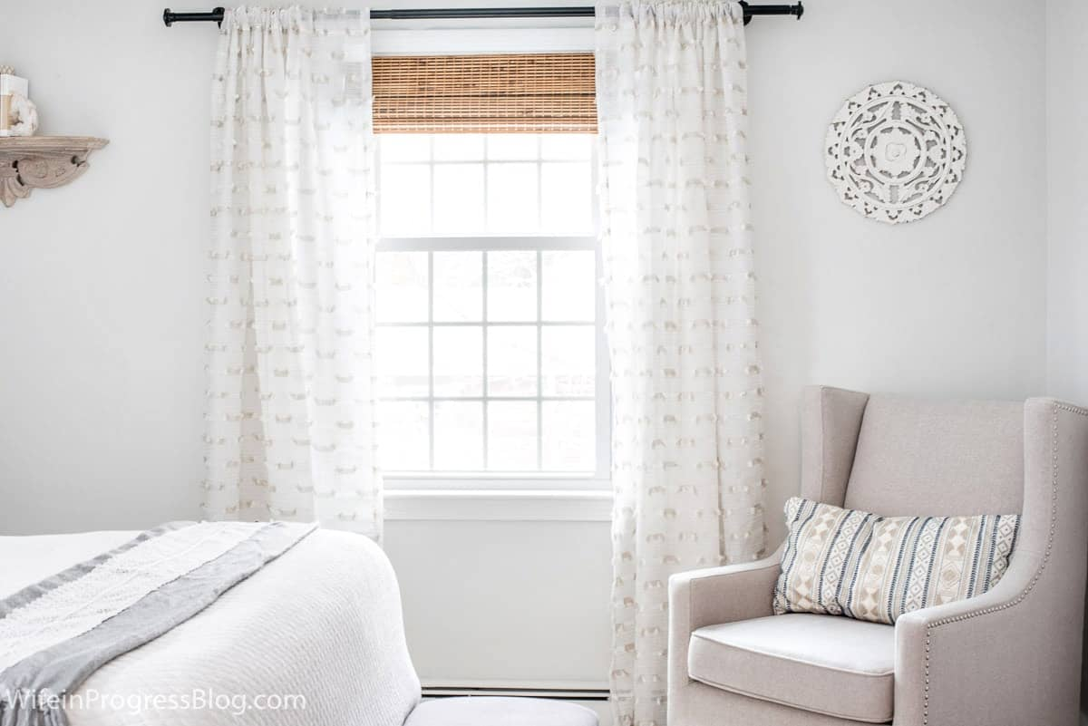 Benjamin Moore Paper White is the perfect paint color for this small master bedroom makeover