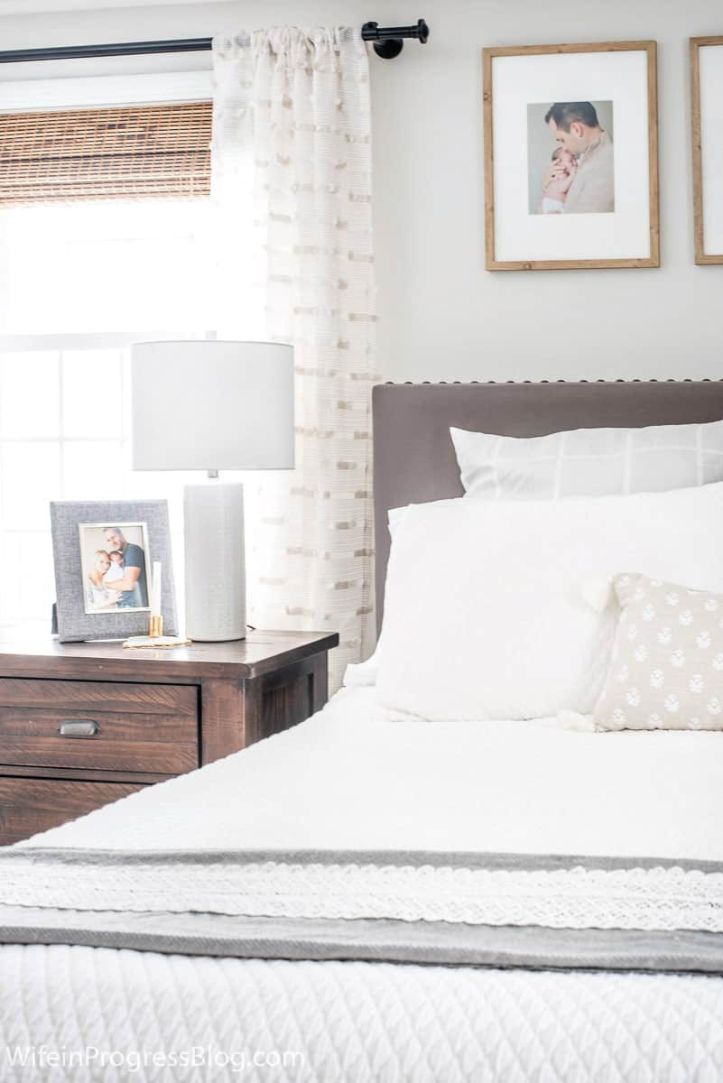 In a small bedroom don't be afraid to put the nightstands in front of the window if it means a more functional space