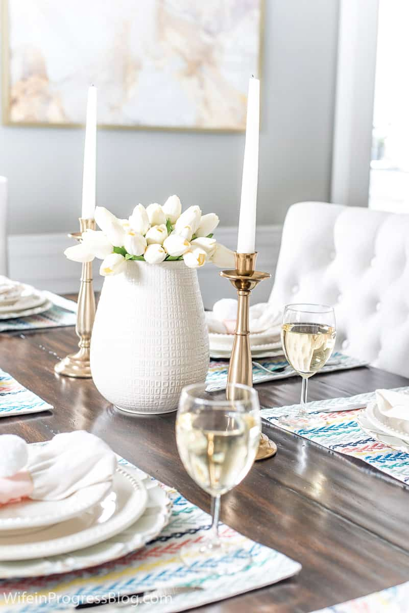 Simple Easter table decor with white tulips and colorful accents