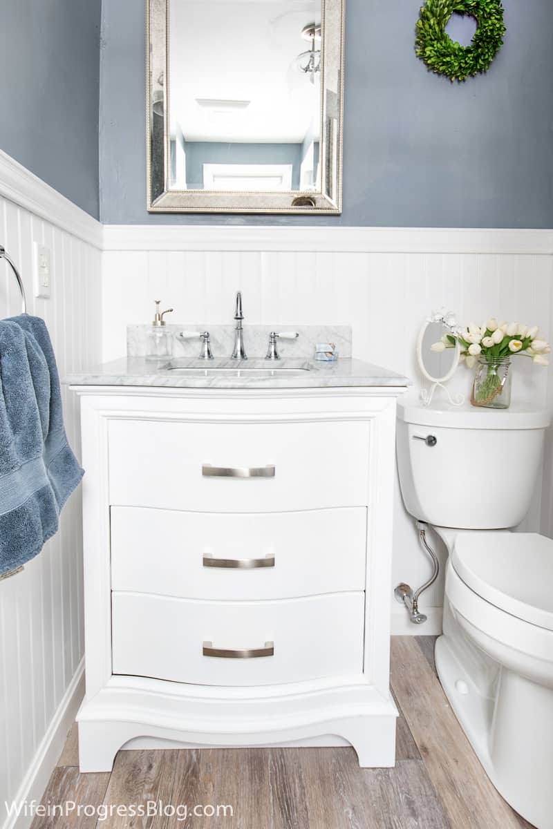 Adding beadboard in your bathroom is a simple DIY that will cover damaged walls and instantly makeover this room in your home.