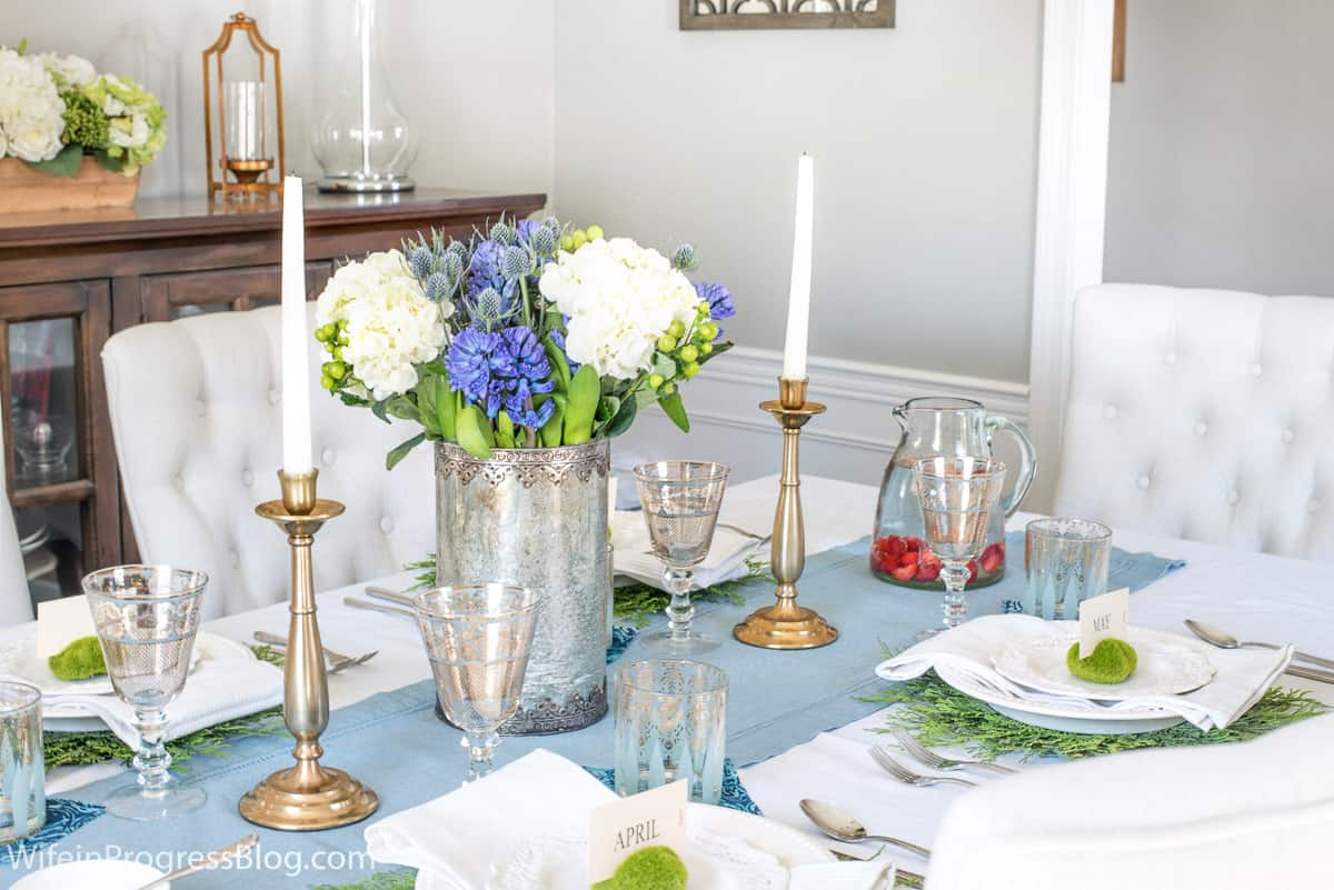 A pretty spring table setting with flowers and pops of green