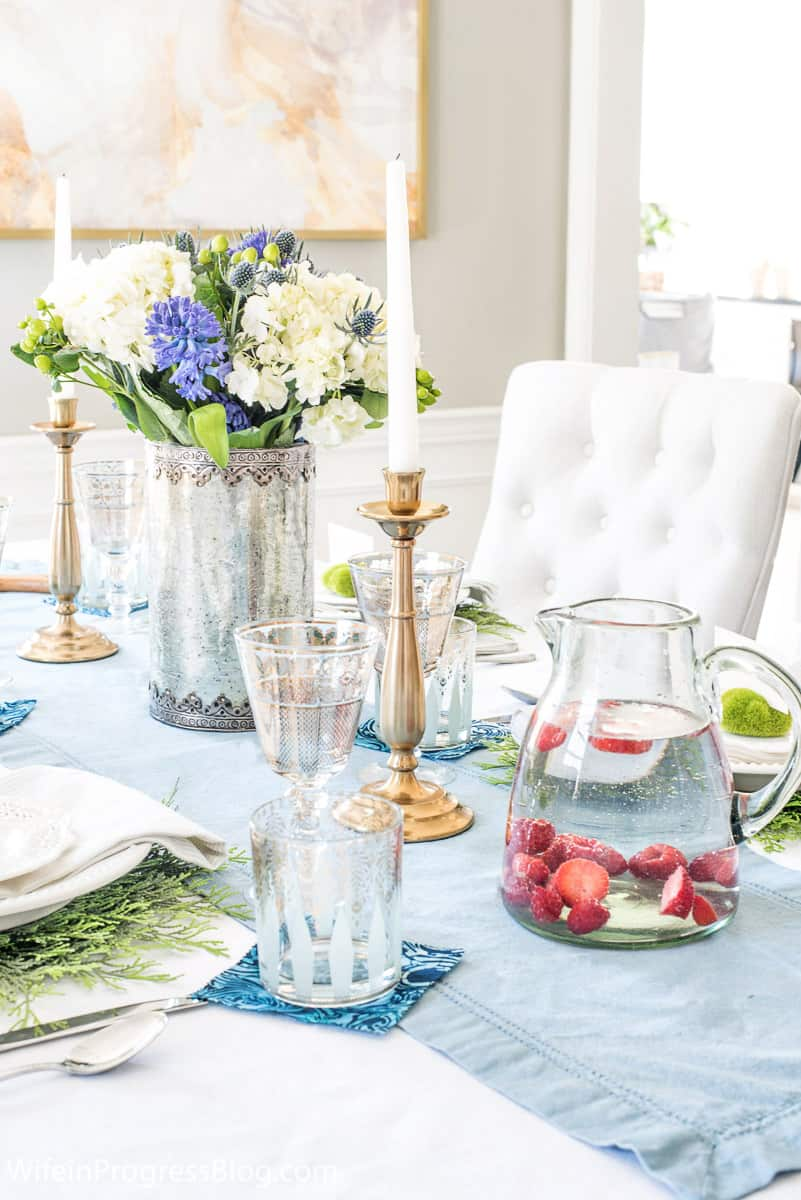 Fruit water with raspberries and strawberries at a spring tablescape dinner party