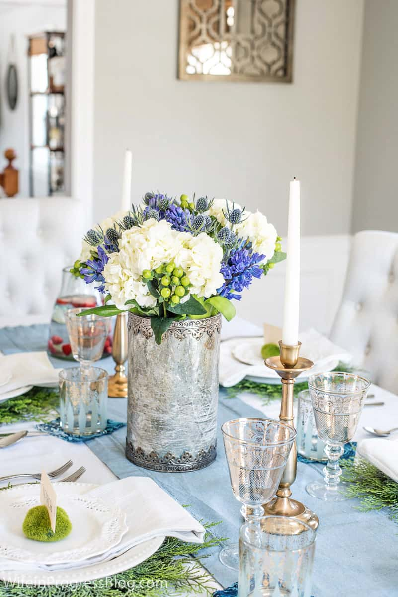 Blue green and white flowers in a spring tablescape