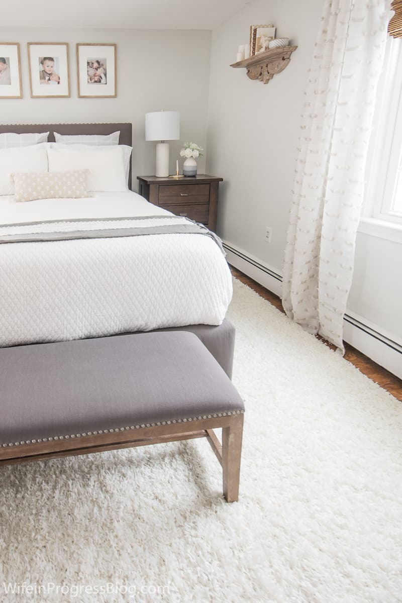 Small master bedroom makeover with Benjamin Moore Paper White on the walls