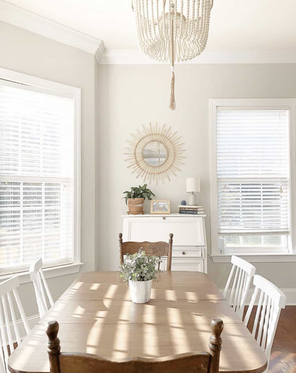 Sun lit dining space shows how much warmth and creaminess can excude from the paint color