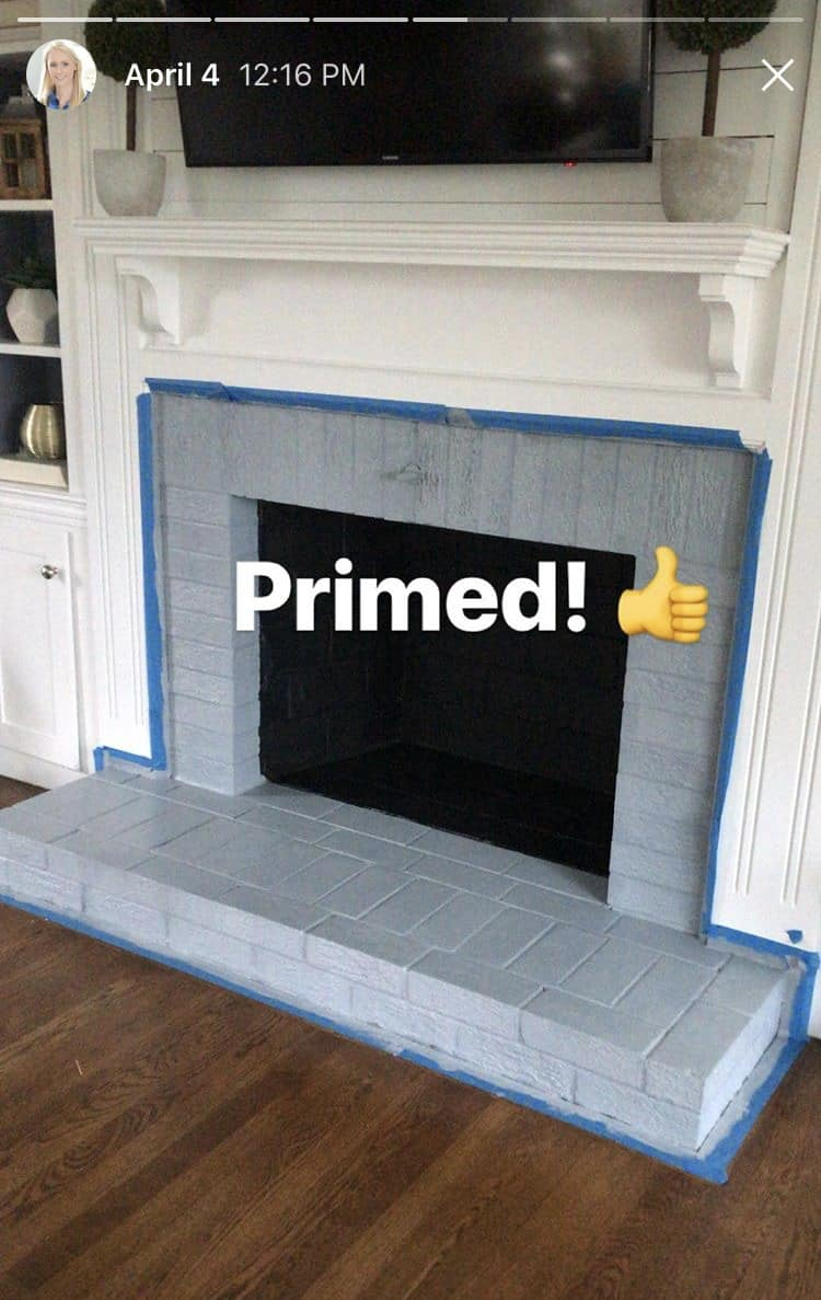 Work in progress: the fireplace is prepped with painter's tape and now completely primed