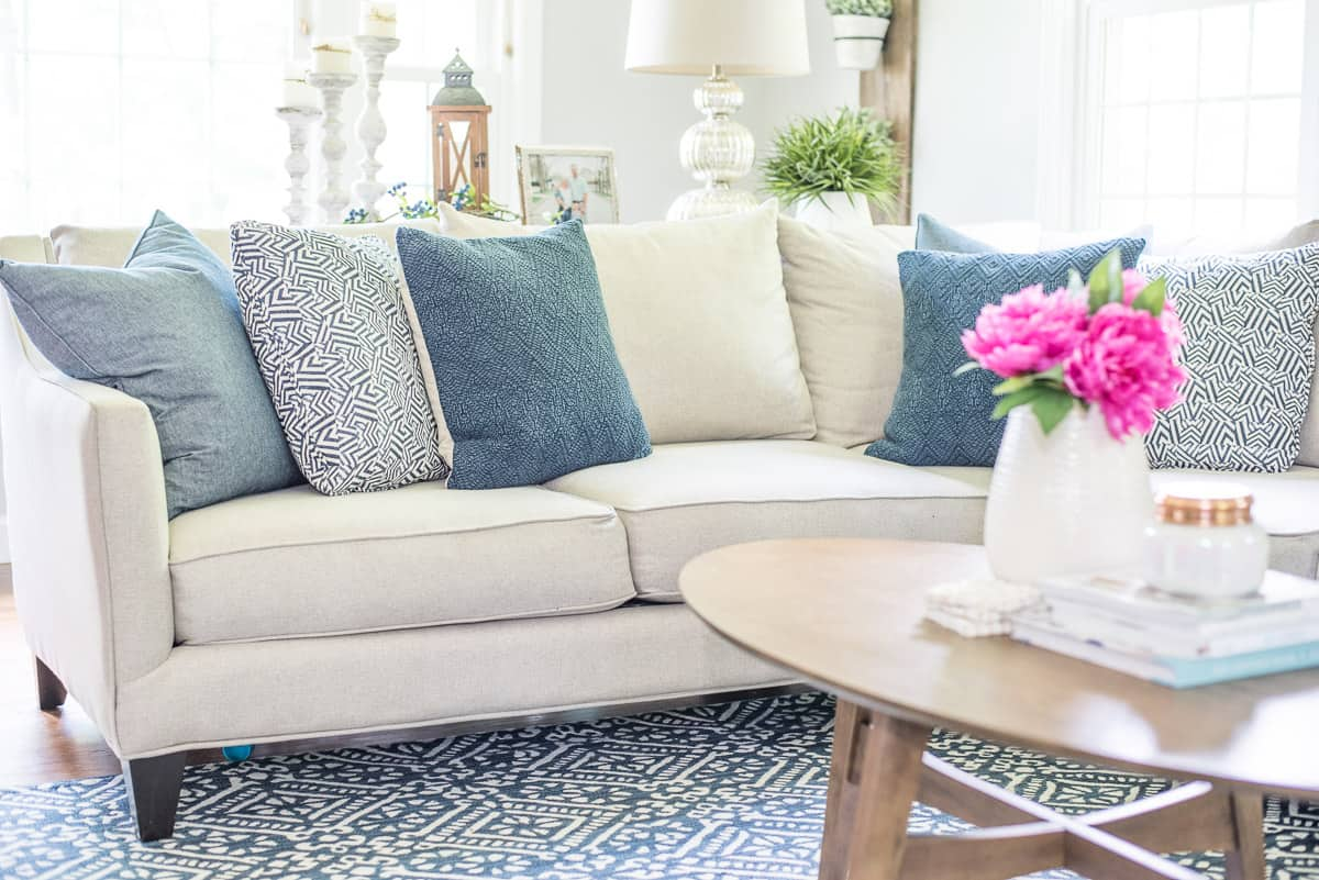 Navy blue and white living room with lots of texture and varying shades of blue.
