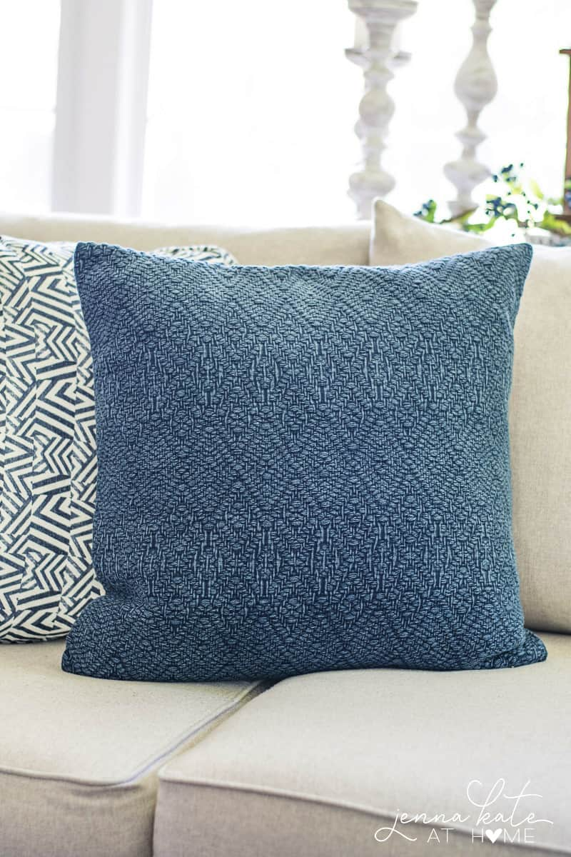 Beautiful textures on this navy blue throw pillow that's perfect for coastal styled homes