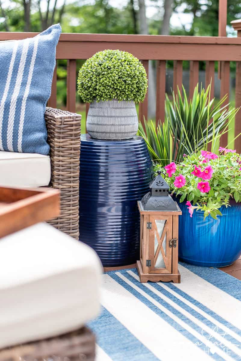 Variety of plants and lanterns to decorate a small deck for summer