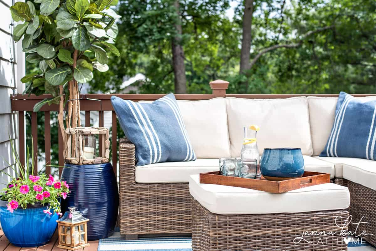 small deck with rattan furniture and blue decorative accents
