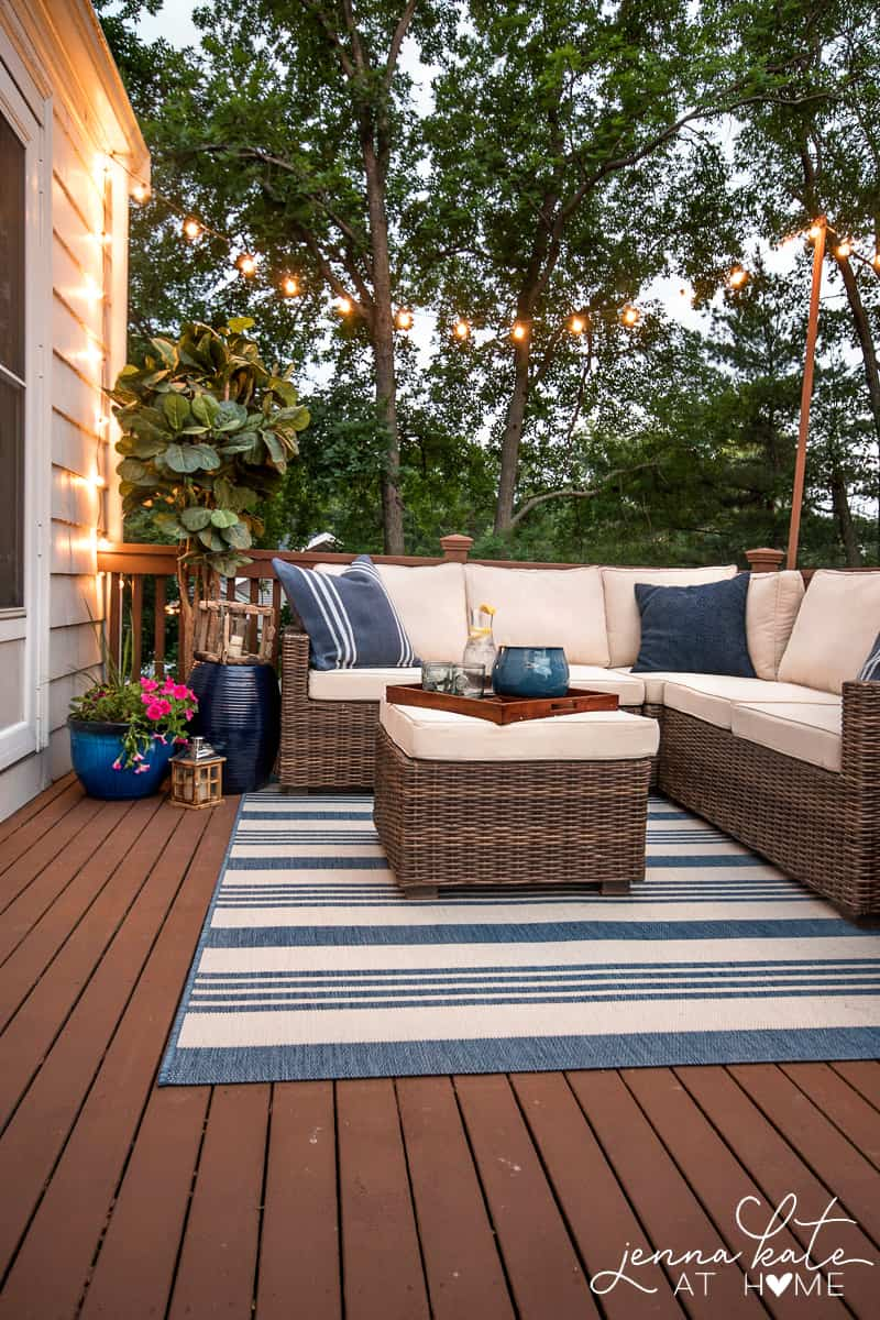 Candles and string lights add a warm, inviting atmosphere to your outdoor entertaining spaces