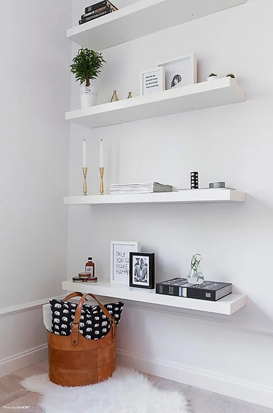 When you have a small bedroom, adding shelves is a clever way to add more storage. When you don't have the floor space for more furniture, think up!