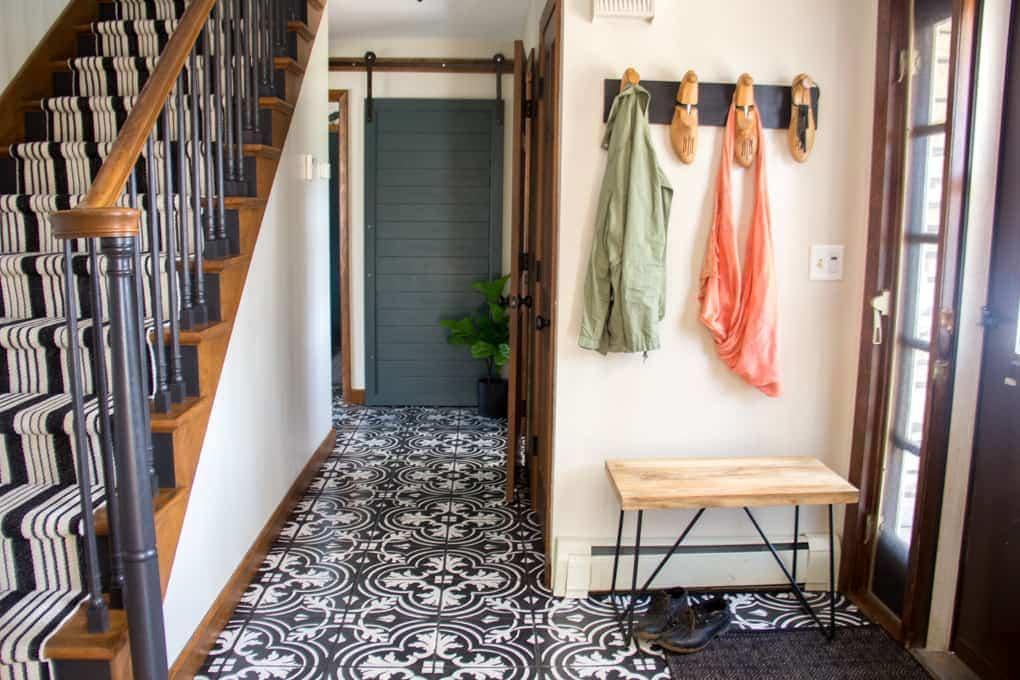 Stenciled tile floor in entryway