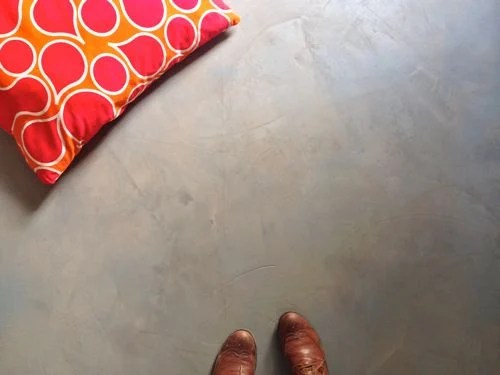 Apply a concrete overlay to your existing subfloor for a cheap flooring solution