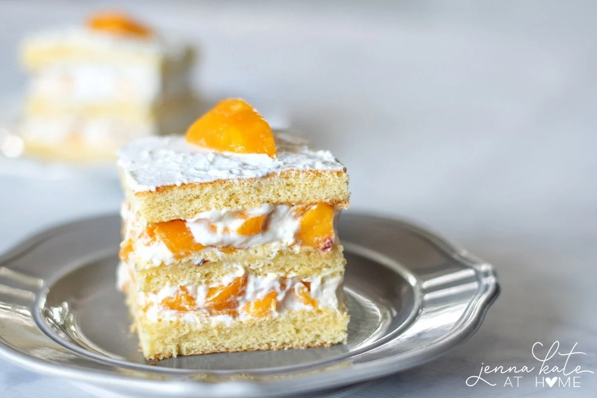 Make this cake with fresh or canned peaches layered between moist sponge and homemade whipped cream