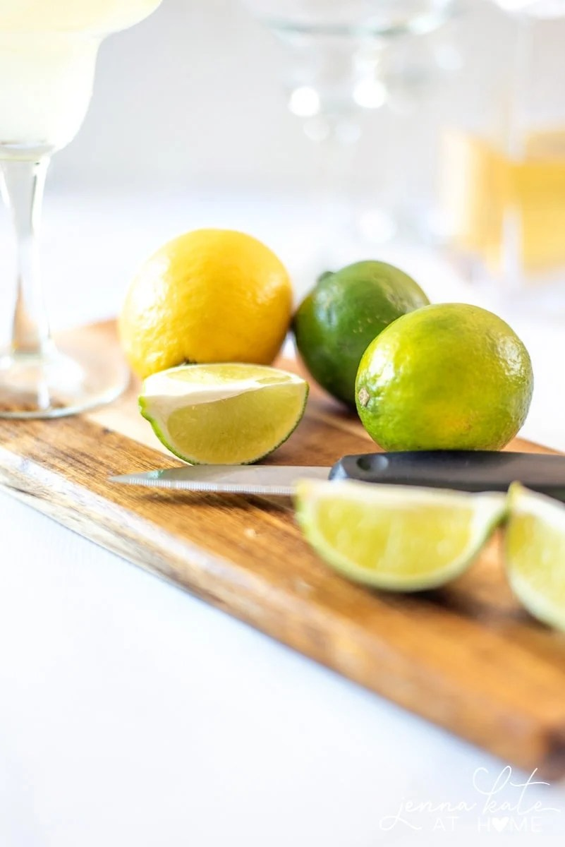 Cut lemons and limes for the homemade margarita mix