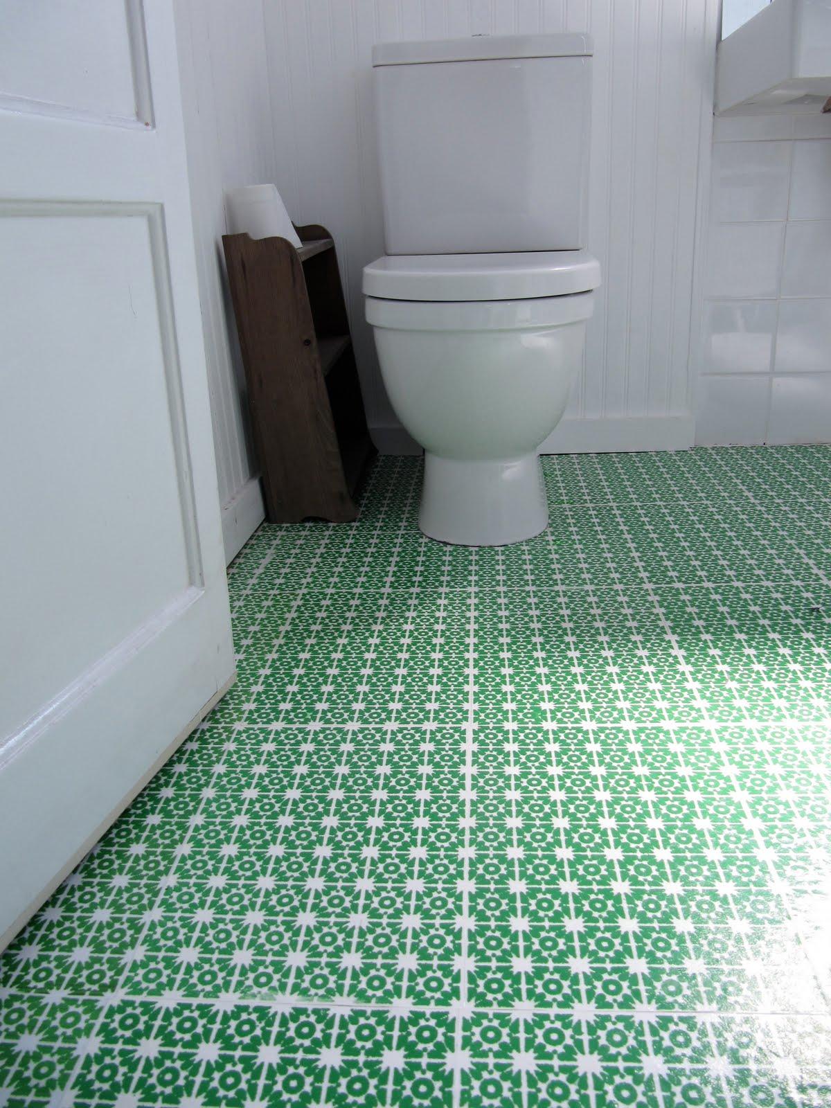 green wallpaper flooring in a bathroom