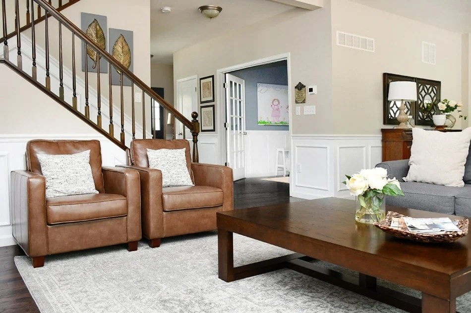 Revere pewter living room walls looking very beige with brown leather furniture and wood accents