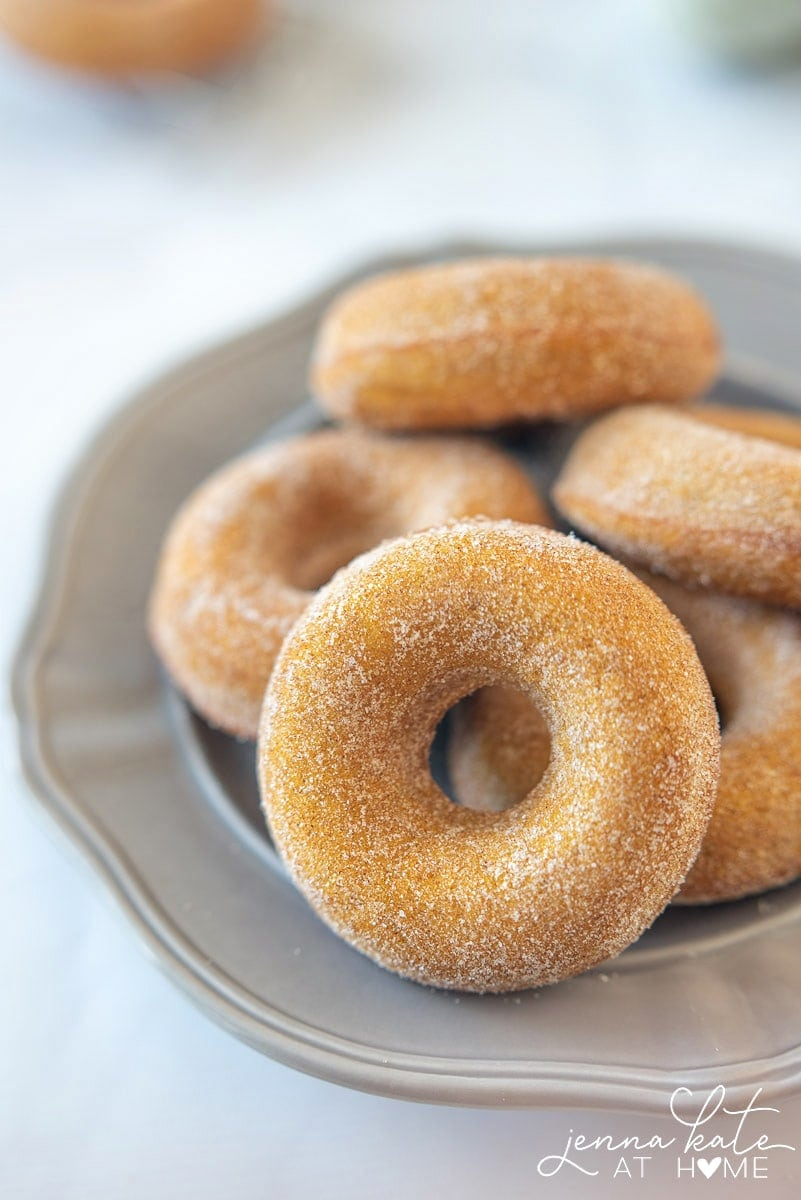 These baked pumpkin spice donuts are coated in cinnamon sugar and are so much easier to make than the yeast variety