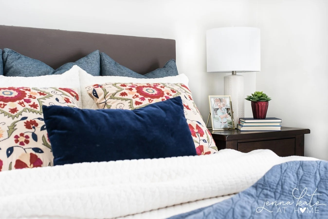 Cozy up your bedroom for fall with floral print pillows on the bed