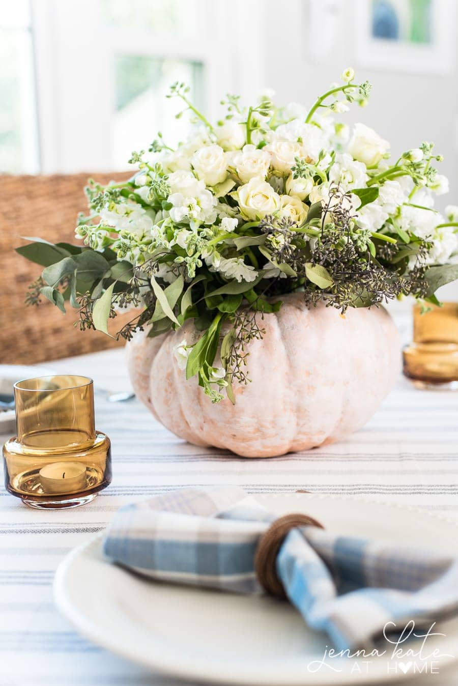 Creating a fall centerpiece with fresh flowers and a pumpkin