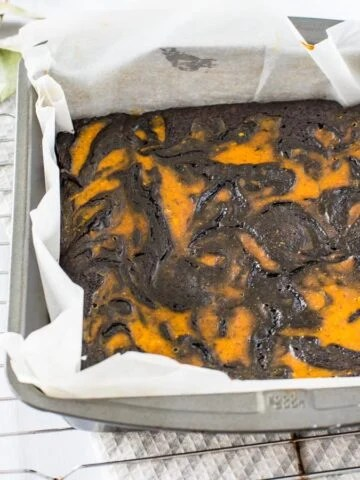 A decadent and fudgy chocolate brownie with a delicious spiced pumpkin swirl. It's the perfect fall dessert!