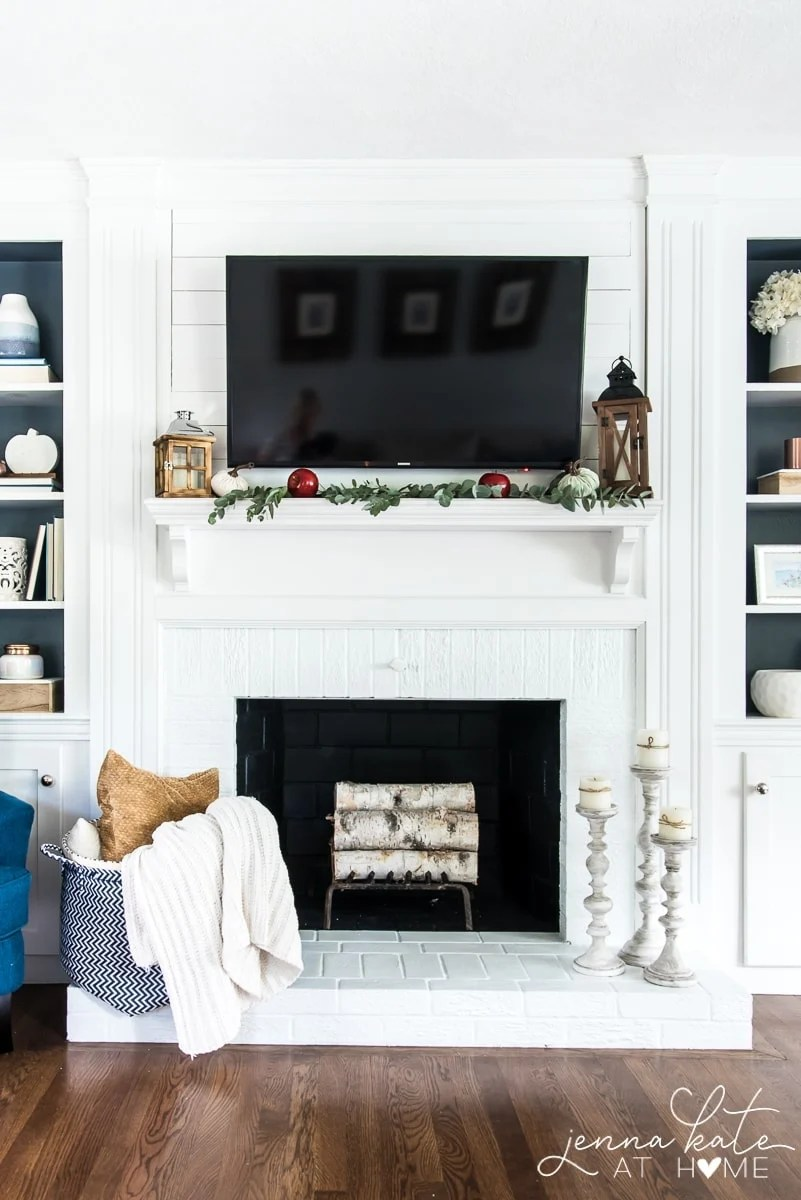 This simple and affordable fall mantel decor is perfect for the winter holidays