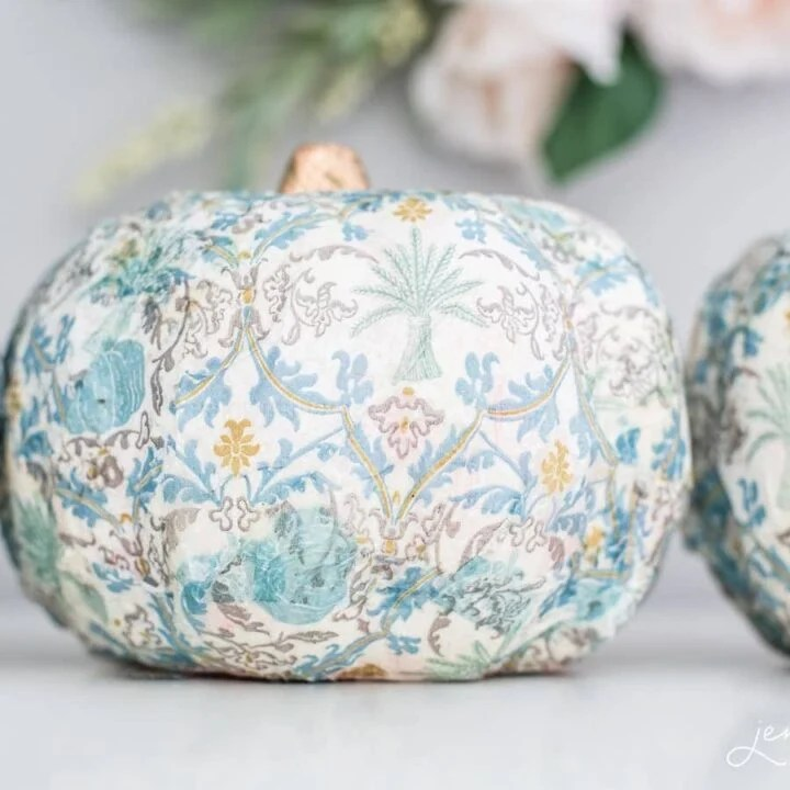 Artificial pumpkin covered in blue, white and gold damask patterned print and a gold stem