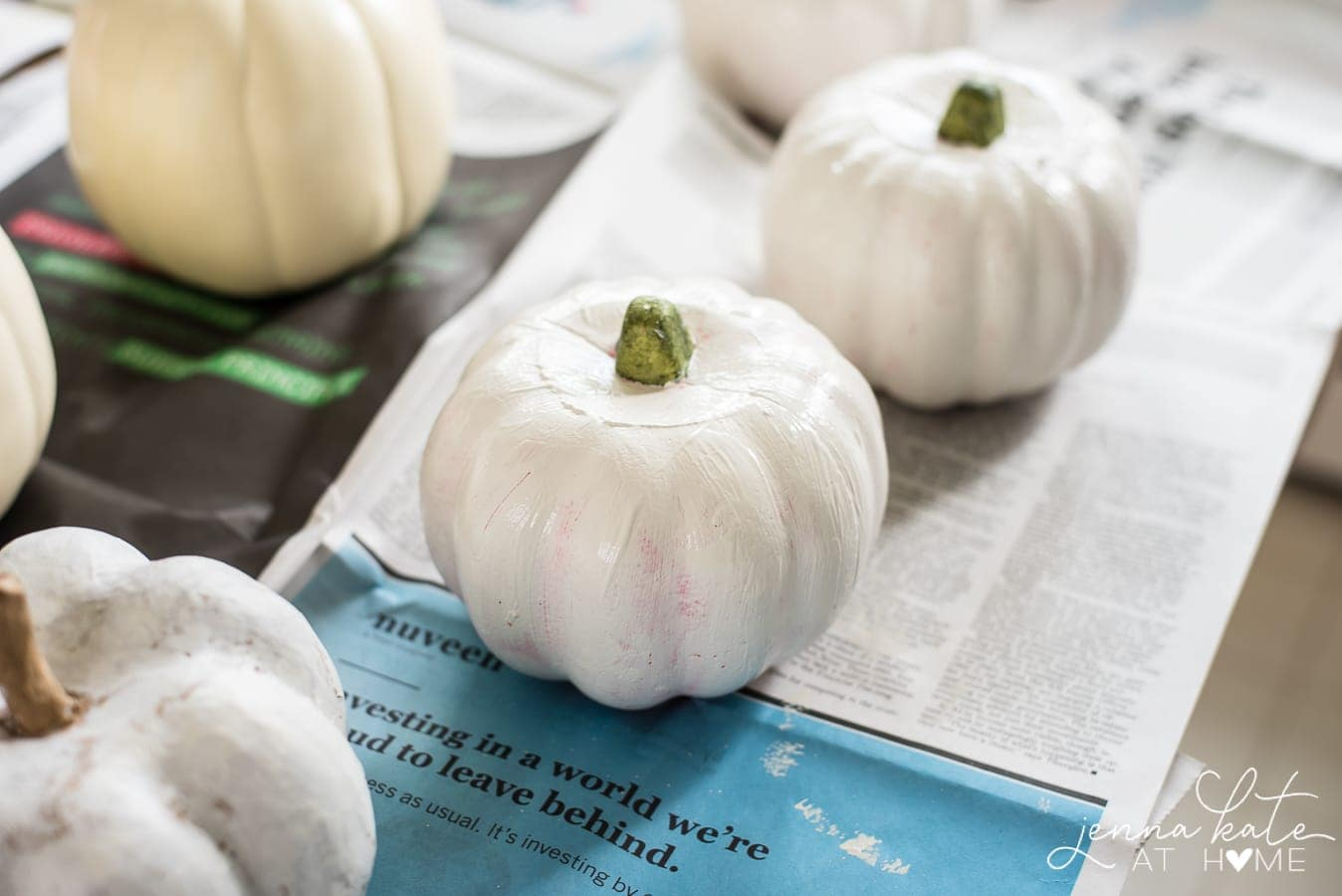 Decoupaging fake pumpkins is an easy fall craft idea for pretty fall decorations