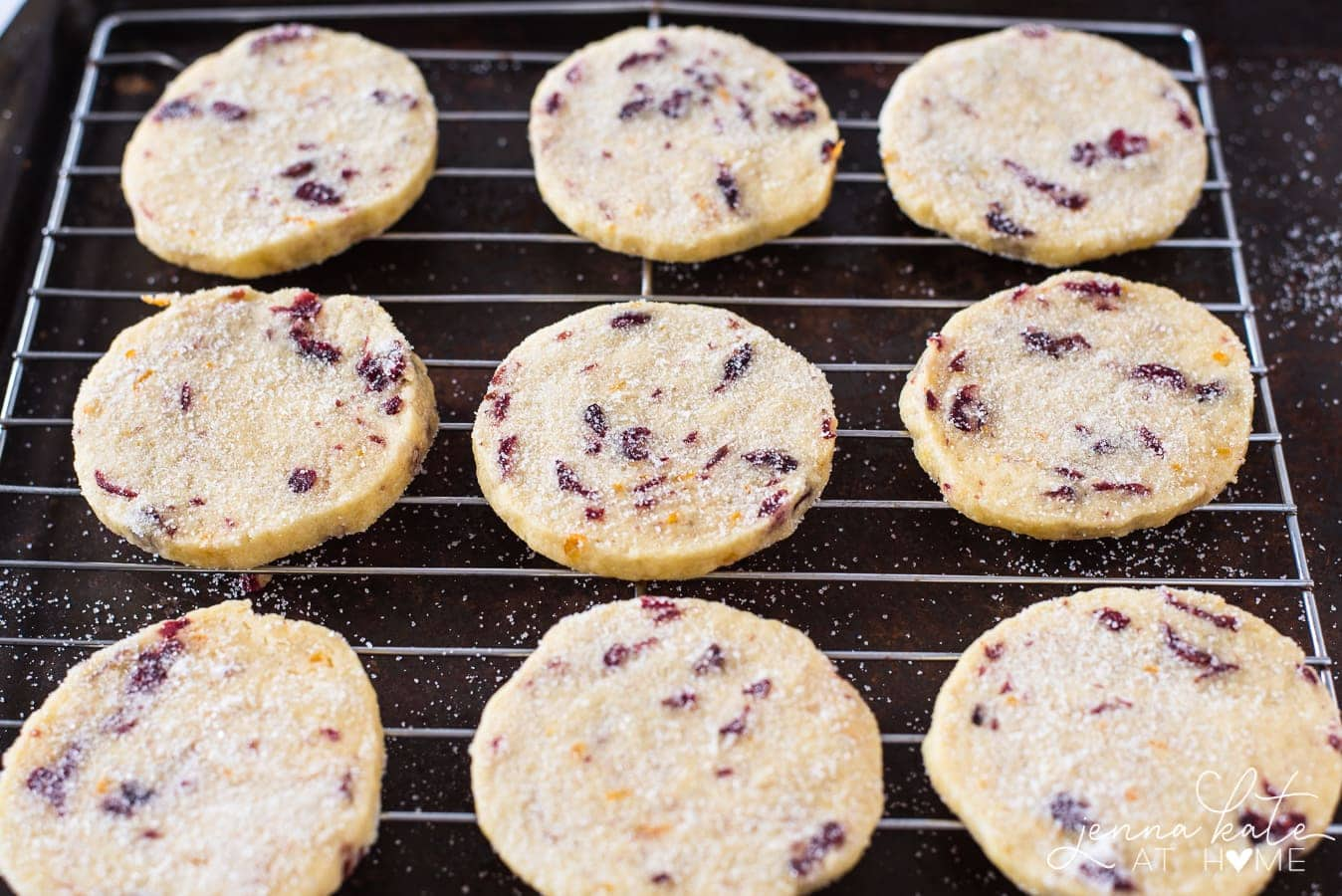 cookies sprinkles with sugar and cooling on a wire rack