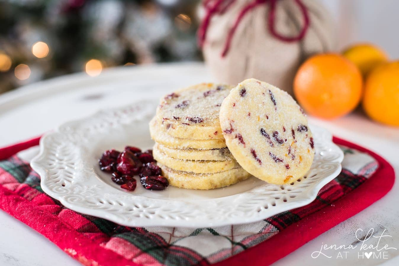 stack of cranberry orange shortbread cookies on a plate