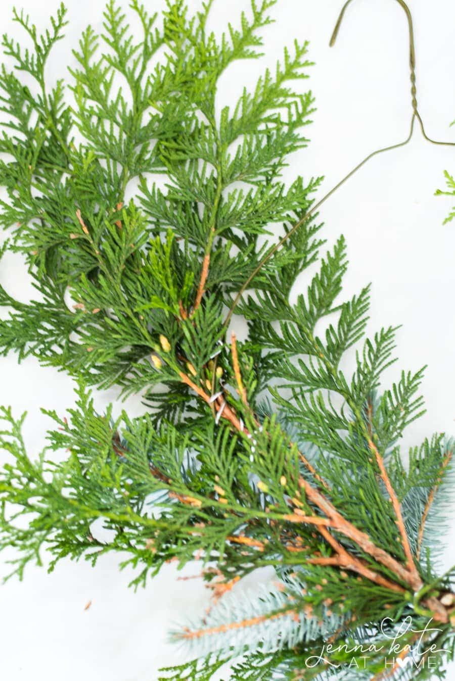 Use a wire hanger to make a DIY evergreen Christmas wreath