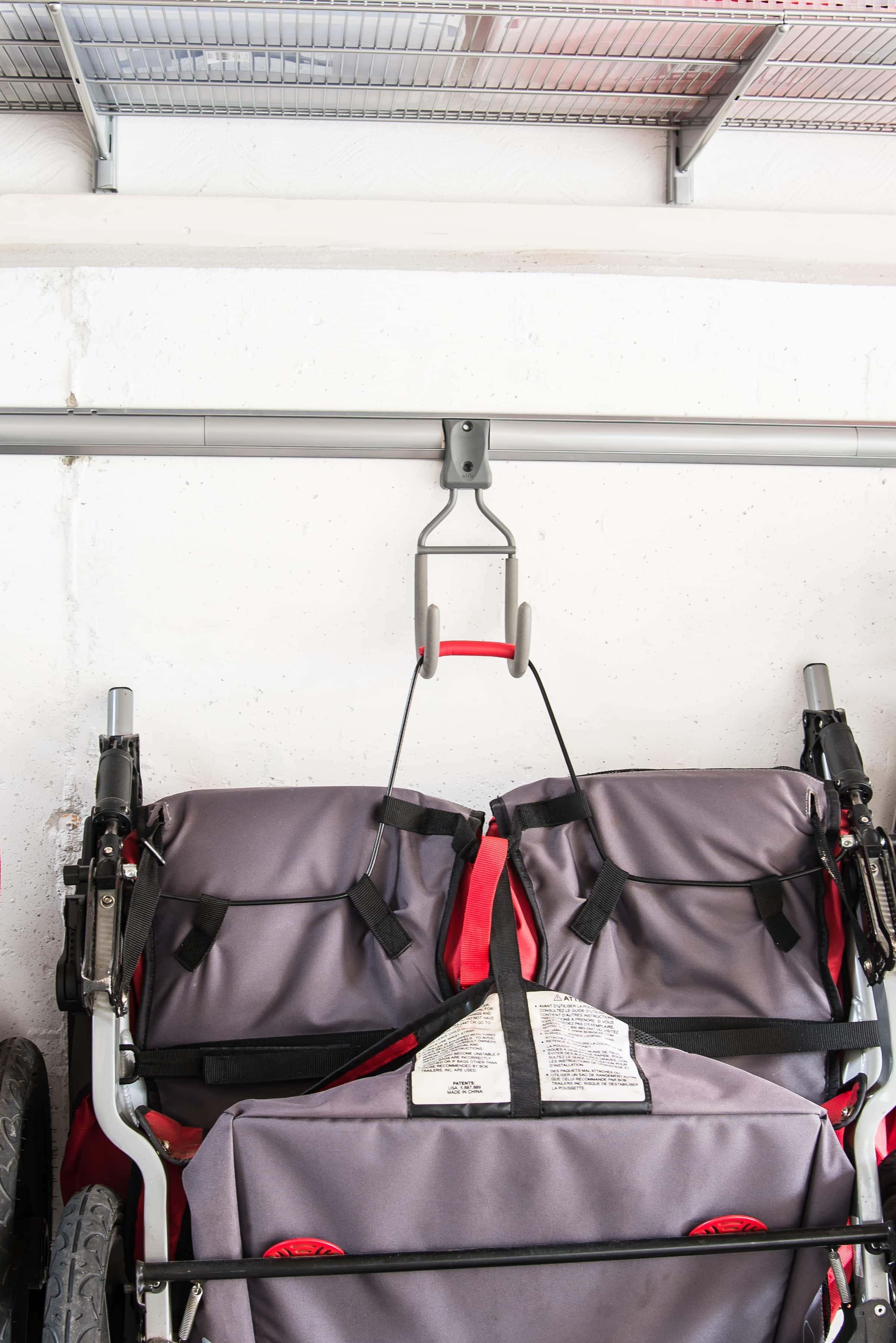 Hooks for hanging strollers in garage
