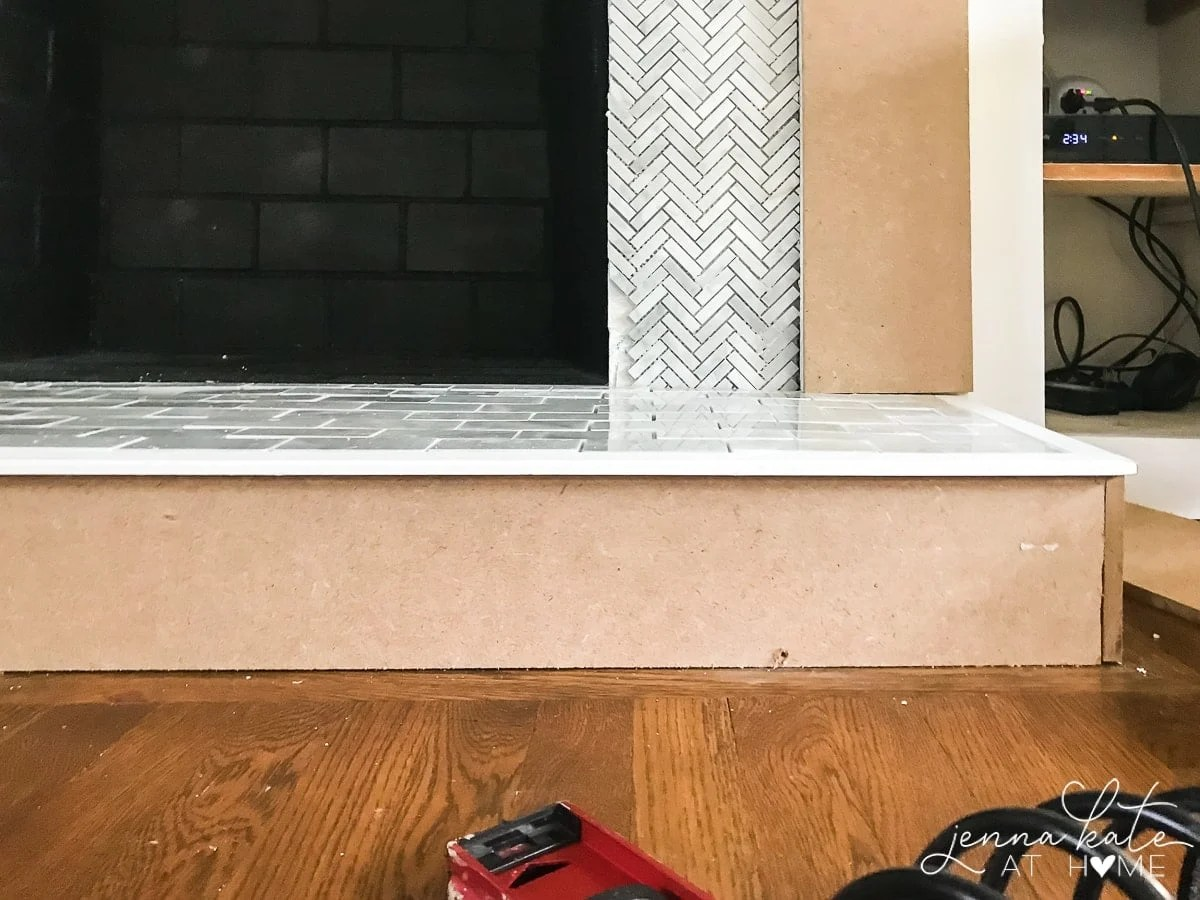 Tiling over painted brick fireplace