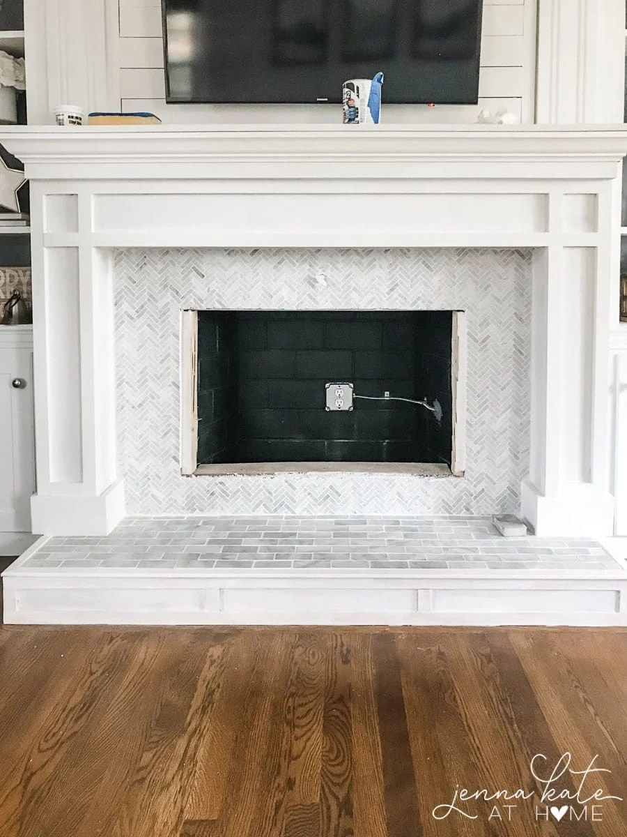Simple wooden fireplace surround with DIY marble tile hearth