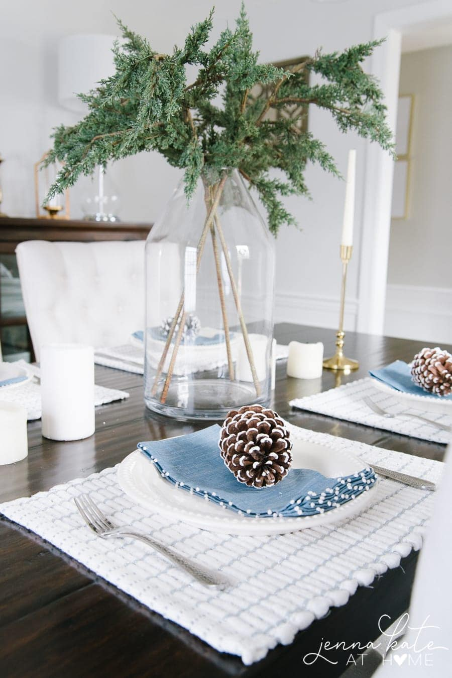 A complete look - pine cones, greenery, soft accents complete the winter tablescape