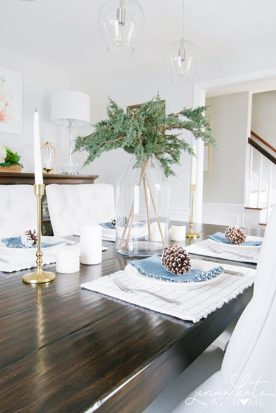 A collection of items on a dining table for a simple winter tablescape