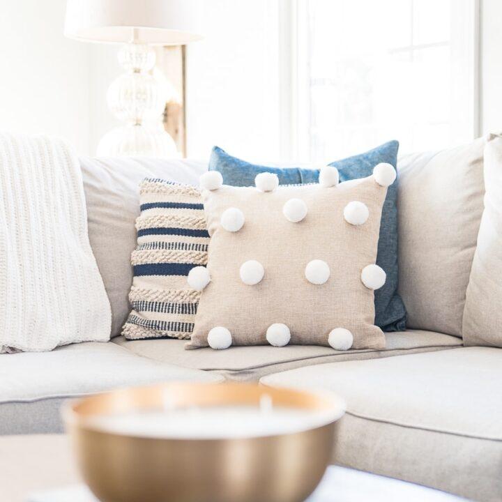 Easy DIY pom pom throw pillow cover tutorial