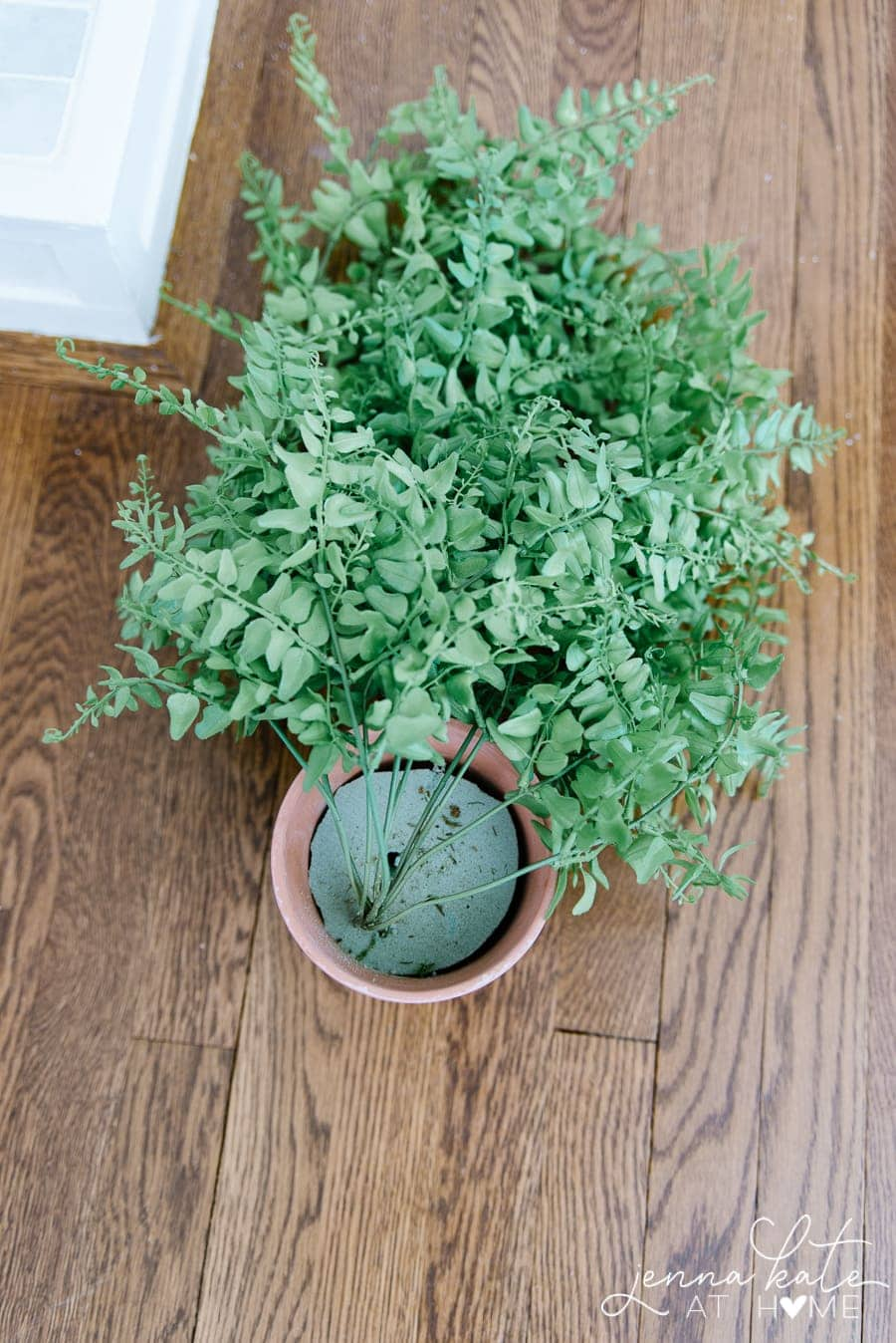 Use floral foam in a classic terra cotta pot to anchor your faux trailing plant