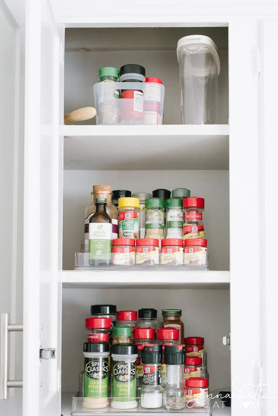 Tiered storage for spices in kitchen cupboards