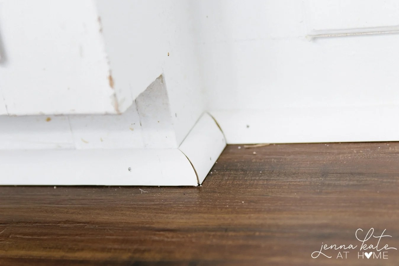 Secure the edges of vinyl plank flooring with shoe molding