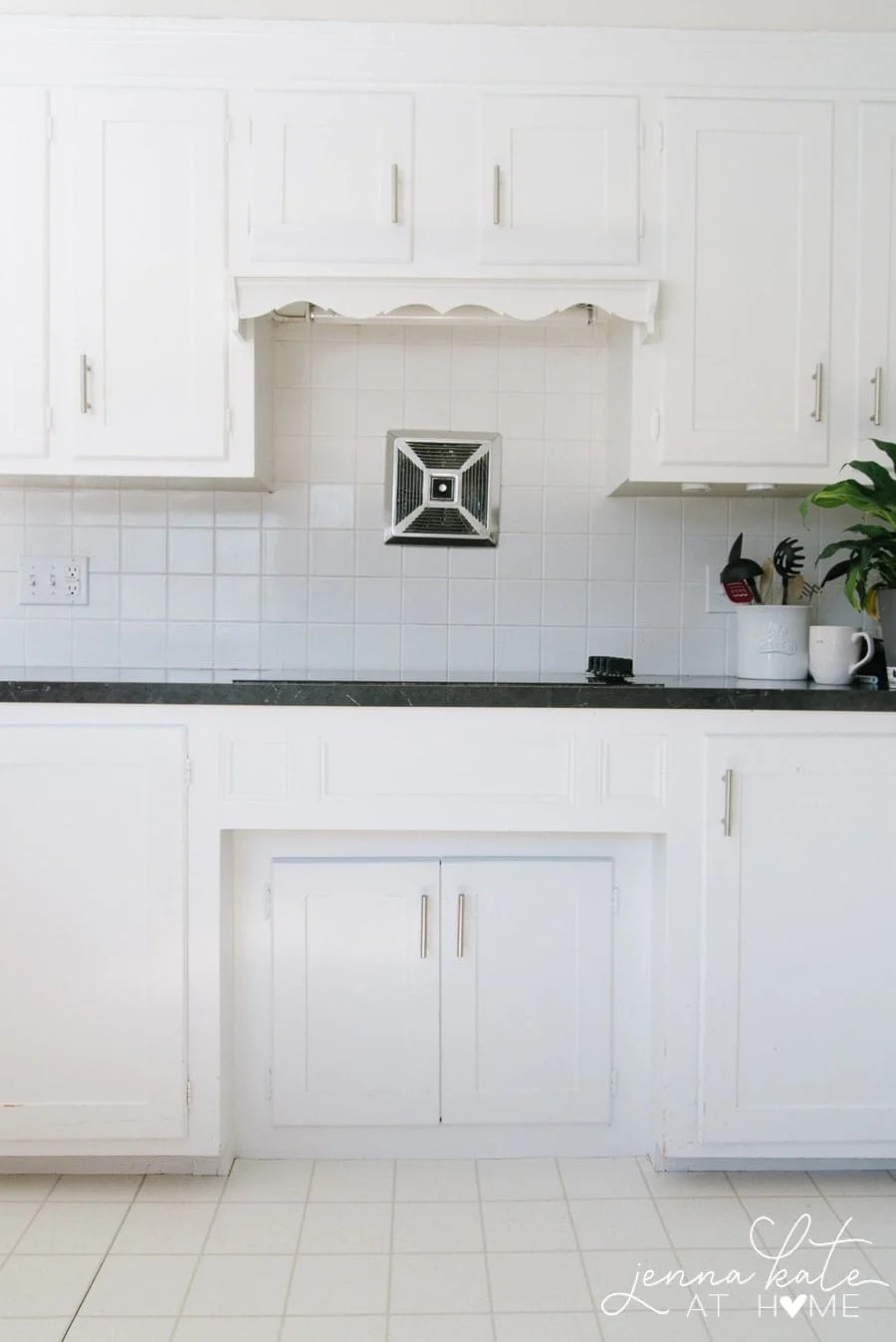 outdated kitchen with scalloped trim over the stove