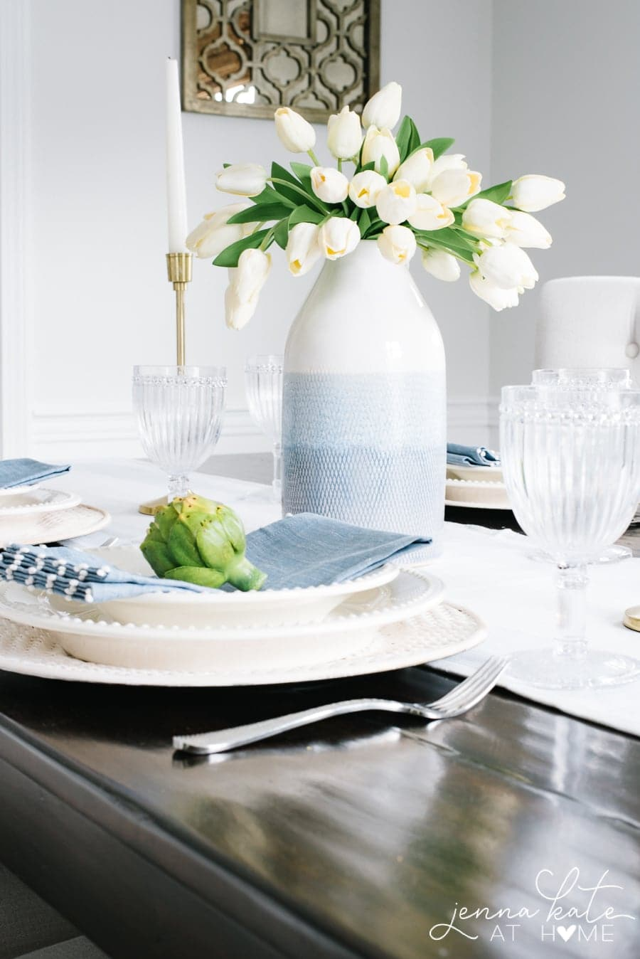 Table setting with a vase full of white tulips