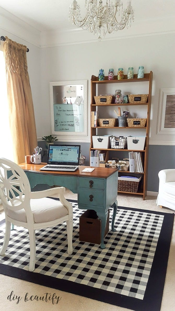 Cohesive baskets on a vintage shelving unit Craft and Office Space Reveal via DIY Beautify Jenna Kate at Home