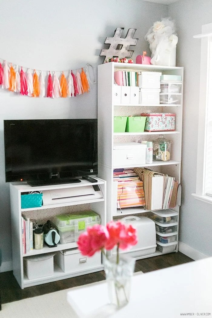 Add fabric backing to decorate inexpensive shelving when organizing and decorating a craft room